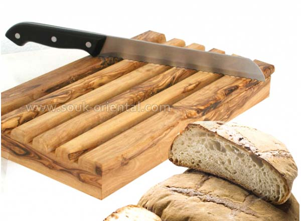 Cut bread into olive wood crafts
